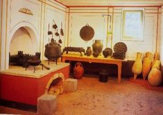 A recreated Roman kitchen in the Pompejanium.