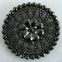 19th century black glass button. Based on Queen Victoria's penchant.