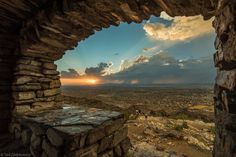 Rock window sunset view. (clouds rain sunrise+sunset Summer sky ). Photo by Drifter50
