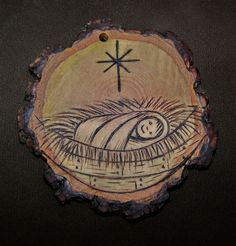 This rustic baby Jesus ornament made from a slice of a Hickory branch would be a perfect addition to your tree :-)  it is about 2 inches in