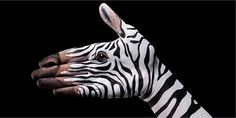 """Artist Guido Daniele's series of paintings called """"Handimals"""" features human hands painted to resemble animal"""