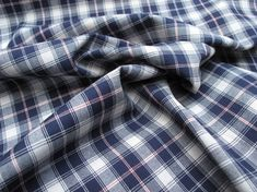A cotton poplin dress fabric with Tartan design.  This fabric has a lovely soft fell and is perfect to sew dresses, shirts, blouses and skirts  100% cotton  148cm wide  All of our dress fabrics are sold by the metre, simply put the number of metres you require into the quantity box.