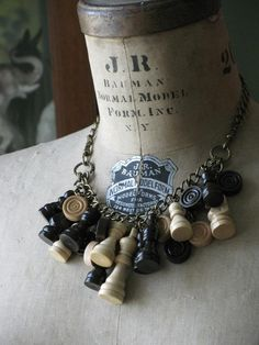 Upcycled Wooden Chess and Checker Piece Statement Necklace - Earth Tones - Great for Fall Fashions - Twilight Inspired Jewelry. $105.00, via Etsy.