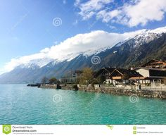 Photo about A shot of the beautiful blue lake shore of Brienze in central Switzerland near Interlaken a large tourist resort town. Image of central, rural, traditional - 70492666 Switzerland, Stock Photos, Mountains, Travel, Image, Beautiful, Viajes, Trips, Traveling