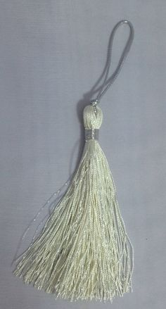 A personal favorite from my Etsy shop https://www.etsy.com/listing/209493107/vanilla-with-silver-metallic-tassel-10