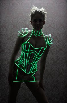 M/L Nude Glowing trim Mini angular PVC lace up Neck Corset Artifice Clothing w Green Glow (production sample ready to ship). $60.00, via Etsy.