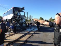 A Via Rail train and a city bus collided in Ottawa's west end Wednesday, Sept. 18, 2013. The front end of the bus was severely damaged. THE ...