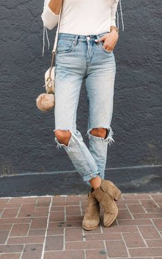 f53b4bd88f4 The perfect light-wash denim! This boyfriend style has the perfect amount  of distressed and pairs great with heels or booties.