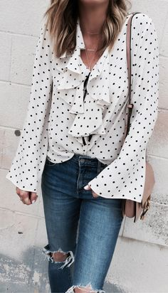 #spring #outfits Pretty Polka Dots Love The Ruffle Detail. // White Dotted Ruffle Shirt + Destroyed Skinny Jeans