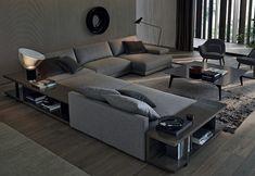 Il divano Bristol disegnato da Jean-Marie Massaud per Poliform abbinato a due madie con vani a giorno attrezzabili