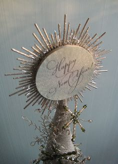 Retrofitted New Year tree topper. See more details at www.thedecoratedtree.blogspot.com