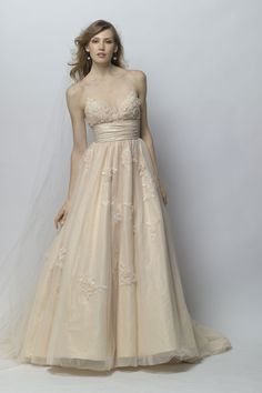 Oriana - Champagne tulle and shimmer taffeta ball gown with tonal Swarovski crystal embellished lace applique bodice, spaghetti straps and draped waist.