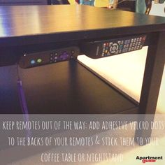 Apartment Hack: Velcro remotes to a coffee table -- oo, great idea!! hate table clutter.