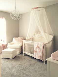Girly pink blush nursery with chandelier, ivory rocker and glider ottoman, and ivory crib canopy. My dream nursery! Baby Boy Cribs, Baby Boy Bedding, Baby Bedroom, Baby Room Decor, Room Baby, Girl Decor, Baby Rooms, Crib Bedding, Kids Bedroom