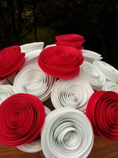"""20 Red and White Alice in Wonderland """"Painting the Roses Red"""" Handmade Paper Flower Bouquet for Brides, Weddings, Showers, Birthdays. $26.95, via Etsy."""