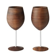 Father's Day Gift - Sip on sweet chardonnay or enjoy an aged cabernet sauvignon with these beautiful wooden wine glasses crafted from gorgeous black walnut wood. Inspired by organic forms and contemporary American designs, maker David Rasmussen created these glasses with an iconic modern aesthetic. The pair makes a perfect gift for an eco-chic host or modern-minded newlyweds. Handmade in Colorado.