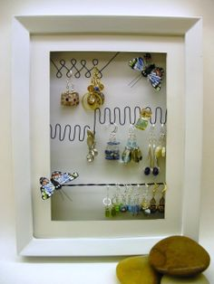 framed. Note the bends and twists in the wire, which would keep earrings in place.  Could easily layer on a pad of some kind and transport this already loaded up.