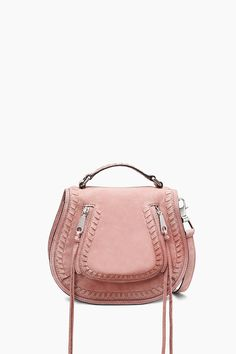 Small Vanity Saddle - The perfect statement saddle bag,just a touch more petite. It comes with a top handle for ladylike vibes and a detachable strap when you just want to be hands free. Whipstitching and tassels add some moto edge. Style #:XU17FNUX42