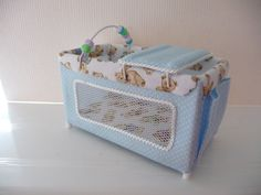 Miniature travel cot/playpen in Blue 1/12th scale. £25.00, via Etsy.