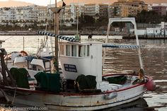 Small fishing boat in fishing port Marbella