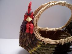 Handmade Rooster Egg Basket made from Tissue paper and basket weave and real Rooster feathers  Measures - 9 high X 12 W to tail feathers.