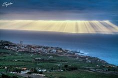 This is about as dramatic as crepuscular rays get, with the sun showing through at the edge of a cloud bank. Photo credit: Cesar Tejedor