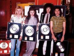 Queen receiving 'A Night At The Opera' UK BPI platinum awards at the Les Ambassadeurs Club in London, September 8th 1976.