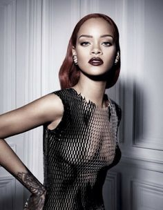 welcome to naija younger's blog: Rihanna goes braless in revealing mesh dress for s...