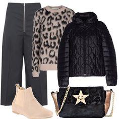 Accoppiata vincente, sempre trendy, il beige si accosta al nero nel maglione stampa animalier. L'outfit è composto poi da: pantaloni ampi e corti, piumino imbottito, chelsea boots ed una borsa bicolore con chiusura a stella.