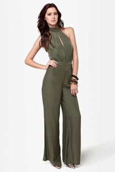 What could be more fun than spending all night in the club with the Bust a Move Olive Green Jumpsuit? Seriously, not only will you get so many compliments on the flattering halter neckline with a sexy little keyhole at front, but the wide-leg pants will make you dance, dance, dance! Adjustable halter ties. Banded waist. Invisible back zipper/hook clasp. Bodice is lined. Model is wearing a size small. 100% Polyester. Hand Wash Cold. Imported.