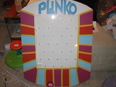 """In this instructable, I'll teach you how to create a """"plinko"""" board for prize giveaways. Alternatively, you can use it as a tribute costume to the Price is Right, like I did! For those not in the know, Plinko is a game on the gameshow the Price is Right. A puck or chip is dropped into the top of a pegboard where it bounces around until finally coming to rest in a prize slot at the bottom of the board. Plinko is a play on the word pachinko."""