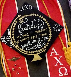 Graduation cap. Be fearless in the pursuit of what sets your soul on fire. Alpha Chi Omega. Job 8:7. German jump wings. Stole. Honors cord. University of North Florida. Law School Bound.