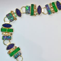 """ The Path"". Boulder opal & drusy bracelet with diamonds & tsavorite in 22k & 18k gold."