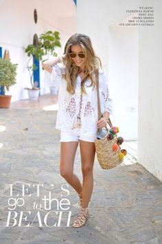 Te Cuento Mis Trucos | by Lola. White laced blouse+white denim shorts+ golden lace up flat sandals+straw tote with colourfull pom poms+sunglasses. Summer outfit 2016