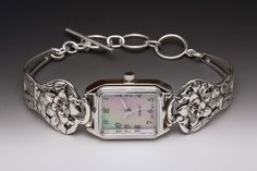 Silver Spoon Rare Mother of Pearl Unique Watch Narcissus Flower Silver Spoon. $123.92. 1 year warranty. Movement by Citizen. Rare and unique, great for gift. Made from finds of unique vintage jewelery. Face is made with Mother of Pearl. Made from Silver Spoon