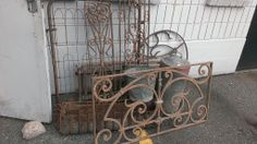 Rusty garden gates and wrought iron antique pieces from Egypt. SO nice for the garden or on a wall!