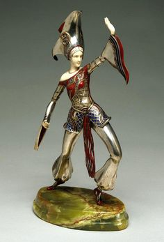 """A typically extravagant chryselephantine by Gerdago (Gerda Iro) (Vienna 1906 -2004) an Austrian sculptor and theatrical/film costume designer (who was often referred to as the """"Austrian Edith head""""). All of her sculptures are beautifully decorated with enamels as can be seen here."""