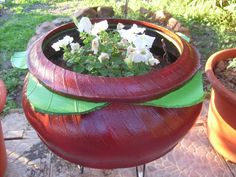 Cute layered planter... reminds me of a tomato.