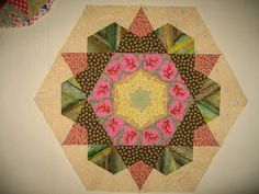 Great way to finish a rose star EPP block.