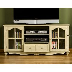 This antique white entertainment center combines modern functionality with an old-fashioned style. The wood media center can accommodate most flat screen televisions. Adjustable shelving and one drawer provide room for media accessories. New Living Room, Living Room Sets, Bedroom Sets, Living Room Furniture, Tv Center, Media Center, Flat Screen Tv Stand, Living Room Entertainment Center, White Tv