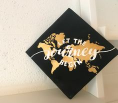Let the journey begin graduation cap with the worlds continents behind it - Graduation day Graduation Cap Toppers, Graduation Cap Designs, Graduation Cap Decoration, Graduation Diy, Grad Cap, High School Graduation, Graduation Pictures, Decorated Graduation Caps, Quotes For Graduation Caps