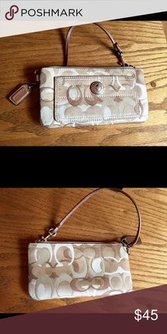 Authentic Coach Signature Wristlet Coach wallet ready for your night out!  Pockets inside and out with a carry strap.  In great shape - no tears or stains. Coach Bags Clutches & Wristlets