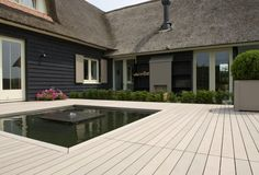 This residential Dutch design combines contemporary elements with traditional Dutch architecture. We love the roof and how it matches the Esthec Terrace.