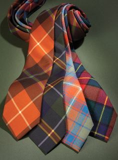 Wool and silk tartan neckties, left to right: P19-A-orange and peat; P19-B-tartan and midnight; BT18-A-chili and Pacific; BT18-C-tartan and red.