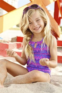 Peixoto Kids ZigZag One Piece This fabulous Peixoto Kids Tamarin One Piece will be on every girl's wish list! It's fun designer print is fun and colorful. The swimsuit has ties in the back which provides the perfect fit for all kids of beach day activities.