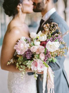 French Grey Events was responsible for this bride's bouquet, which featured lilacs, ranunculus, roses, tulips, and poppies.