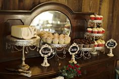 Opulent Treasures Antique Silver Chandelier #Cakestands look gorgeous next to this dark wood! #Desserttable ~ Rustic Red Celebration in Athens - Athens, GA | Borrowed & Blue