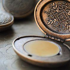 Natural perfume locket with Victorian diamond design. $45