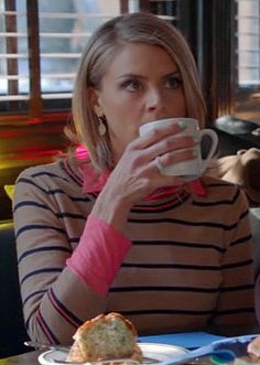 Jane's camel brown sweater with navy and pink stripes on Happy Endings http://wornontv.net/10977