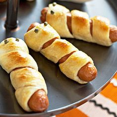 Great for a classroom Halloween party.   Ghost hotdogs. You could use veggie dogs (Big Jims) for vegetarian kiddos.
